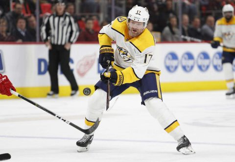 Nashville Predators left wing Scott Hartnell (17) dumps the puck into the zone during the first period against the Detroit Red Wings at Little Caesars Arena. (Raj Mehta-USA TODAY Sports)