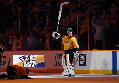 Nashville Predators goalie Pekka Rinne (35) is awarded the first star of the game after recording his 300th career win with a win over the San Jose Sharks at Bridgestone Arena. (Christopher Hanewinckel-USA TODAY Sports)