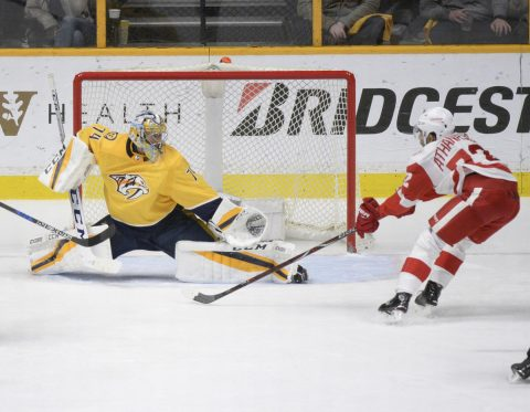 Nashville Predators goalie Juuse Saros (74) blocks the shot of Detroit Red Wings left wing Andreas Athanasiou (72) during the third period at Bridgestone Arena. ( Steve Roberts-USA TODAY Sports)