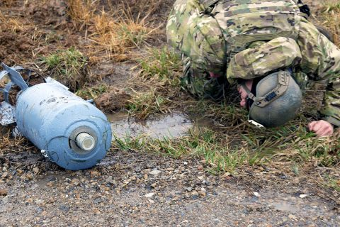 Sgt. Josh Wilson, an explosive ordnance disposal team leader with 49th Ordnance Company (Explosive Ordnance Disposal), 184th Ordnance Battalion (EOD), 52nd Ordnance Group (EOD), 20th Chemical, Biological, Radiological, Nuclear and high-yield Explosive Command, examines a simulated round for additional triggers on the training areas of Fort Campbell, Ky., Feb. 22, 2018. (U.S. Army photo by Staff Sgt. Adam Hinman)