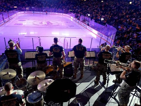 Members of the 101st Airborne Division Brass Band, perform during the New Jersey Devils vs Nashville Predators hockey game at Bridgestone Arena in Nashville March 10. The band was performing in support of the Predators Military Salute Week. (Capt. Jennifer Cruz, 40th Public Affairs Detachment)