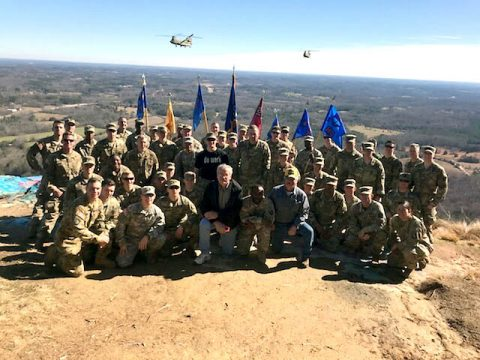 Junior officers, company command teams, and primary staff from 6th General Support Aviation Battalion, 101st Aviation Regiment, 101st Combat Aviation Brigade, 101st Airborne Division, gather for a photo with veterans, atop Currahee Mountain, near Toccoa, Georgia, the birthplace of the 101st, February, 7, 2018. (U.S. Army photo)