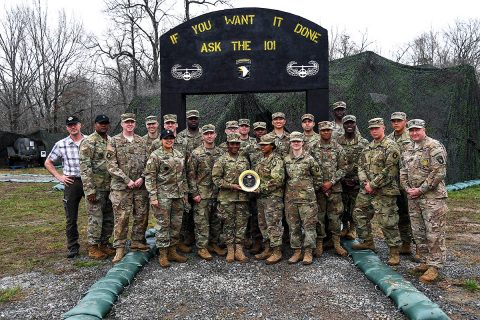 Soldiers from E. Company, 6th General Support Battalion, 101st Combat Aviation Brigade, 101st Airborne Division (Air Assault) receive an award February 28, 2018, at Fort Campbell, Ky. The Soldiers competed in the 50th Annual Phillip A. Connelly Competition, a competition that recognizes units for superb performance and provides innovative training that has a sustainable impact on current and future missions in garrison and field environments. (Sgt. Marcus Floyd, 101st Combat Aviation Brigade)