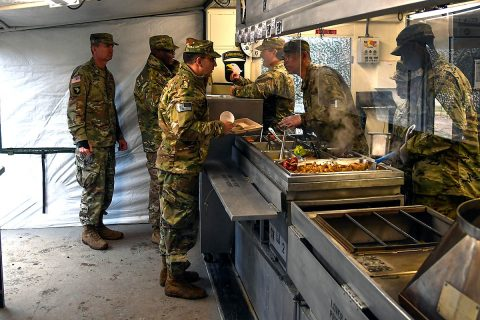 Soldiers from E. Company, 6th General Support Battalion, 101st Combat Aviation Brigade, 101st Airborne Division (Air Assault) serve food to the 101st CAB command team, Col. Craig Alia and Command Sgt. Maj. Reginald Thomas, February 28, 2018 at Fort Campbell, Ky., during the 50th Annual Phillip A. Connelly Competition. The Soldiers are competing at the Department of the Army level of the competition and representing Forces Command. (Sgt. Marcus Floyd, 101st Combat Aviation Brigade)