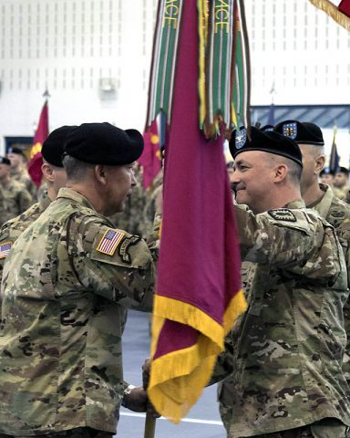 Col. Mark R. Faria, right and former commander of the 52nd Ordnance Group (EOD), 20th Chemical, Biological, Radiological, Nuclear and high-yield Explosive Command, relinquishes the unit's colors to Brig. Gen. James E. Bonner, commanding general of the 20th CBRNE Cmd. during a change of command ceremony in Sabo Physical Fitness Center on Fort Campbell, KY, Mar. 14, 2018. (U.S. Army photo by Staff Sgt. Adam Hinman, 52nd Ordnance Group)