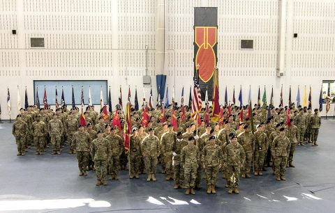 Soldiers of the 52nd Ordnance Group (Explosive Ordnance Disposal), 20th Chemical, Biological, Radiological, Nuclear and high-yield Explosive Command, stand ready before a change of command ceremony in Sabo Physical Fitness Center on Fort Campbell, Ky., Mar. 14, 2018. This ceremony allowed the group to honor its outgoing commander, Col. Mark R. Faria, and welcome its new commander, Col. Daniel J. Duncan. (U.S. Army photo by Staff Sgt. Adam Hinman, 52nd Ordnance Group)