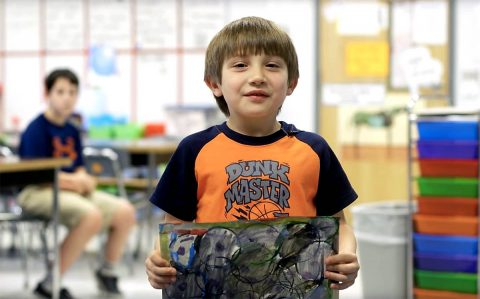 Clarksville-Montgomery County School System student showing artwork.