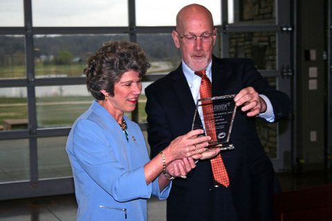 Clarksville Mayor Kim McMillan accepts the Partner America Small Business Advocate Award from Jeff Bean, Managing Director at the U.S. Conference of Mayors, on Wednesday. McMillan said she accepted it on behalf of the local businesses and City departments who made it possible.