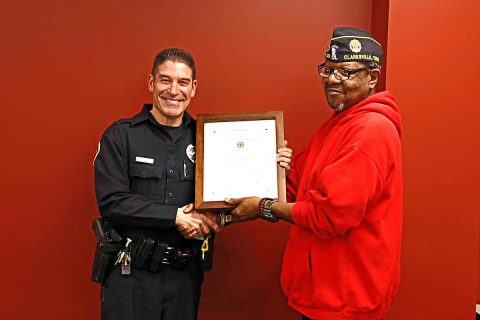 American Legion Fort Campbell Post 289 presents Clarksville Police Officer Coz Minetos with the Law Enforcement Officer of the Year plaque.