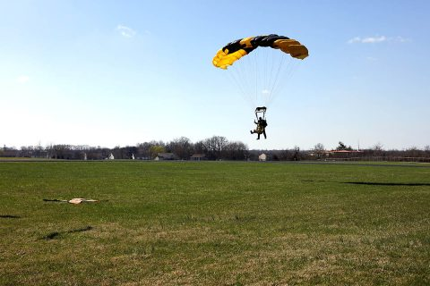 A tandem instructor and passenger execute a picture perfect landing after a successful jump at 13,500 feet on Outlaw Field, TN on March 1st, 2018. (Sgt. John Miller)