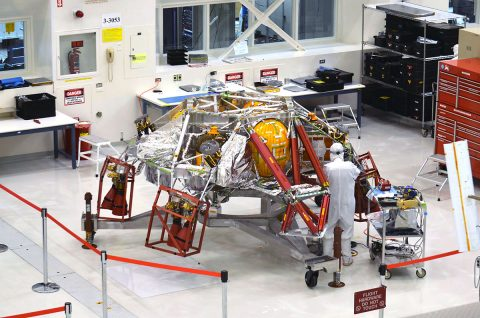 A technician works on the descent stage for NASA's Mars 2020 mission inside JPL's Spacecraft Assembly Facility. Mars 2020 is slated to carry NASA's next Mars rover to the Red Planet in July of 2020. (NASA/JPL-Caltech)