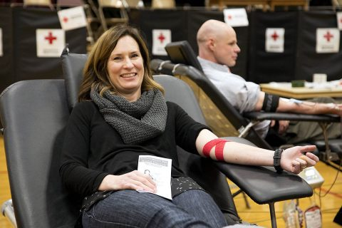 Heidi Reed relaxes in a donor chair following her blood donation. Reed's mother received blood during a surgery. (Amanda Romney, American Red Cross)