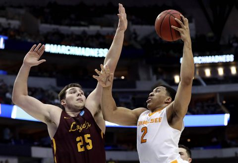 Tennessee Volunteers forward Grant Williams (2) shoots as Loyola (Il) Ramblers center Cameron Krutwig (25) defends during the first half in the second round of the 2018 NCAA Tournament at American Airlines Center. (Matthew Emmons-USA TODAY Sports)
