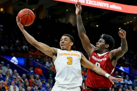 Tennessee Volunteers guard James Daniel III (3) drives in for a layup attempt as he is pressured by Arkansas Razorbacks guard Jaylen Barford (0) during the first half of the semifinals of the SEC Conference Tournament at Scottrade Center. (Billy Hurst-USA TODAY Sports)