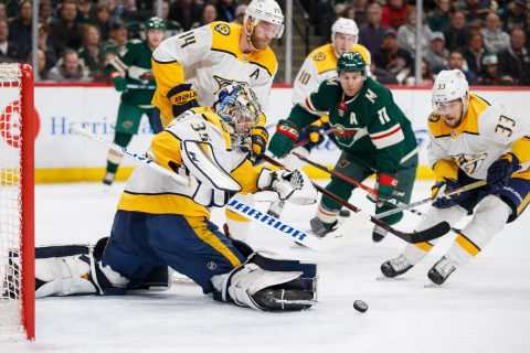 Mar 24, 2018; Saint Paul, MN, USA; Nashville Predators goalie Pekka Rinne (35) makes a save in the second period against Minnesota Wild forward Zach Parise (11) at Xcel Energy Center. Mandatory Credit: Brad Rempel-USA TODAY Sports