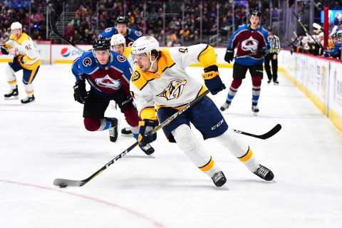 Colorado Avalanche defenseman Tyson Barrie (4) chases down Nashville Predators left wing Filip Forsberg (9) in the first period at the Pepsi Center. (Ron Chenoy-USA TODAY Sports)