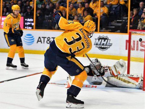 Nashville Predators left wing Viktor Arvidsson (33) scores past Anaheim Ducks goalie John Gibson (36) during the third period at Bridgestone Arena. (Christopher Hanewinckel-USA TODAY Sports)
