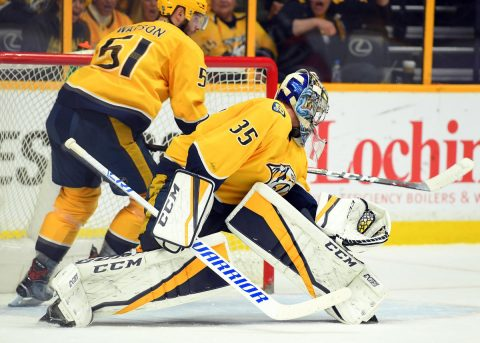 Nashville Predators goalie Pekka Rinne (35) watches as left wing Austin Watson (51) hits the puck out of the crease during the third period against the Winnipeg Jets at Bridgestone Arena. Mandatory Credit: Christopher Hanewinckel-USA TODAY Sports
