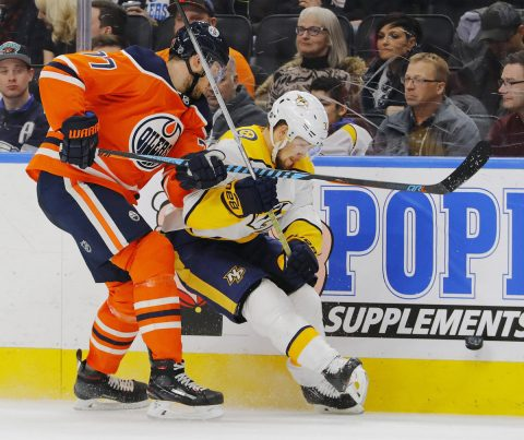 Edmonton Oilers defensemen Oscar Klefbom (77) and Nashville Predators forward Viktor Arvidsson (33) battle for a loose puck during the second period at Rogers Place. (Perry Nelson-USA TODAY Sports)
