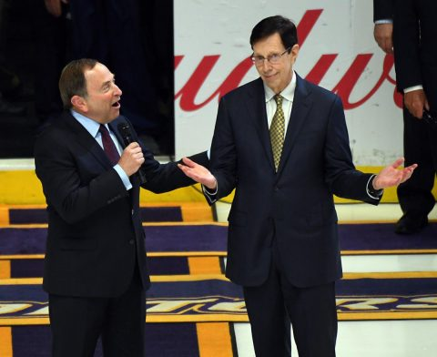 Nashville Predators general manager David Poile (right) is honored by NHL Commissioner Gary Bettman for being the winningest general manager in NHL history before a game between the Predators and the Anaheim Ducks at Bridgestone Arena. (Christopher Hanewinckel-USA TODAY Sports)