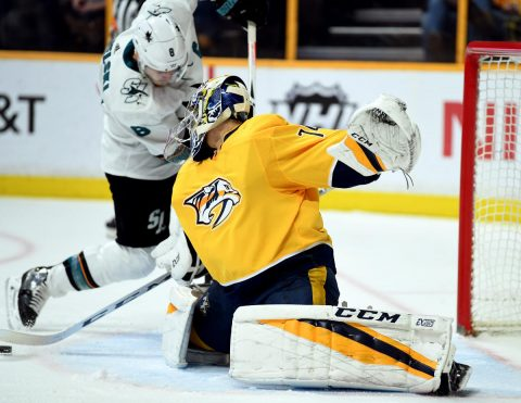 Nashville Predators goalie Juuse Saros (74) blocks a shot by San Jose Sharks center Joe Pavelski (8) during the second period at Bridgestone Arena. (Christopher Hanewinckel-USA TODAY Sports)