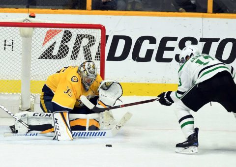 Nashville Predators goalie Pekka Rinne (35) stops a shot by Dallas Stars center Mattias Janmark (13) during the third period at Bridgestone Arena. (Christopher Hanewinckel-USA TODAY Sports)