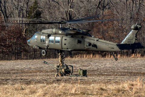 Artillerymen from B Battery, 3rd Battalion, 320th Field Artillery Regiment, 101st Airborne Division Artillery Brigade, 101st Airborne Division (Air Assault), rig an M119A3 howitzer to a UH-60 Black Hawk helicopter before conducting air assault operations, January 24, 2018, at Fort Campbell, Kentucky. Sling loading the howitzers allows the artillerymen to occupy remote locations more rapidly to effectively fire upon the enemy. (Spc. Patrick Kirby, 40th Public Affairs Detachment)
