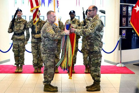 Maj. Gen. Andrew Poppas, 101st Airborne Division (Air Assault) commander and Command Sgt. Maj. Todd Sims, 101st Abn. Div. senior enlisted leader, case the division headquarters' colors, April 3, at McAuliffe Hall, in advance of the unit's deployment, its fourth to Afghanistan in the last decade. (Sgt. Samantha Stoffregen, 101st Airborne Division (Air Assault) Public Affairs)