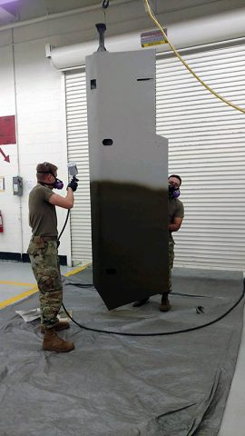 Pfc. Daniel Watts, a Soldier with B. Company, 96th Aviation Support Battalion, 101st Combat Aviation Brigade irons the fabric of a damaged glider wing November 7, 2017 at Fort Campbell, Ky. During the Don F. Pratt Museum renovation, a unit mascot damaged the wing of a World War II era-glider and a team of seven Soldiers from the 101st CAB repaired the wing. (Staff Sgt. Ian Thompson, 101st Combat Aviation Brigade)
