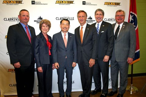 Tennessee Governor Bill Haslam and state and local leaders join ATLASBX CEO Ho Youl Pae after an announcement that ATLAS BX will build a $75 million battery manufacturing plant in Clarksville.