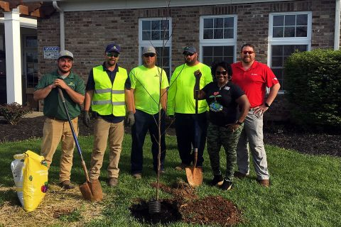 Representatives from the Exchange, Mainscape and Campbell Crossing, helped kick off the Earth Day Extravaganza with the planting of a shade tree.