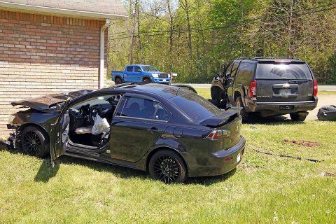 Clarksville Police responded to a vehicle accident on Ringgold Road where a Mitsubishi Lancer left the road due to high speed of travel, collided with a Chevrolet Suburban, and came to rest near a home, Monday. (Jim Knoll, CPD)