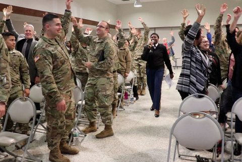 Blanchfield Army Community Hospital's Chief of Occupational Therapy and Installation Ergonomics Officer, Lt. Col. Colleen Daniels has participants of Fort Campbell's Dental Activity keep their arms raised in the air for about two minutes to demonstrate how remaining in one position for a long period of time can cause muscle strain. Daniels spoke at the DENTAC's Safety Stand Down, April 6 to share how ergonomics can reduce muscle strain and prevent injuries in their work center. (U.S. Army photo by Maria Yager)