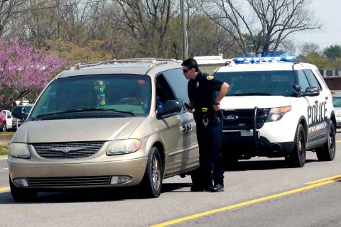A Clarksville Police Officer with someone pulled over for Distracted Driving. (Doug Burgess)