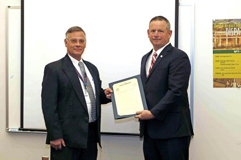 Director Brian Hitchcock and Montgomery County Mayor Jim Durrett holding the Joint Proclamation for National Public Safety Telecommunicators Week. (Jim Knoll, CPD)