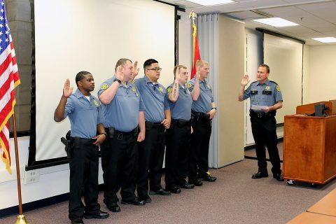 Richard Byers, Travis Roberts, Jeffrey Siu, Emmanuel Vaughn, and Daniel Williams sworn in by Montgomery County Sheriff John Fuson.