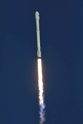 A SpaceX Falcon 9 rocket soars upward after lifting off from Space Launch Complex 40 at Cape Canaveral Air Force Station in Florida, carrying NASA's Transiting Exoplanet Survey Satellite (TESS). Liftoff was at 6:51 p.m. EDT. TESS will search for planets outside of our solar system. The mission will find exoplanets that periodically block part of the light from their host stars, events called transits. The satellite will survey the nearest and brightest stars for two years to search for transiting exoplanets. (NASA/Kim Shiflett)