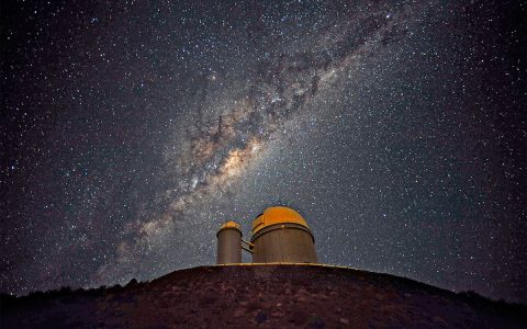 The Milky Way, our own galaxy, stretches across the sky above the La Silla telescope in Chile. Hidden inside our own galaxy are trillions of planets, most waiting to be found. (ESO/S. Brunier)