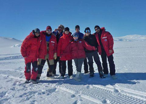 The ANSMET 2017-2018 team on the ice shelf near McMurdo station. (Scott van Bommel)