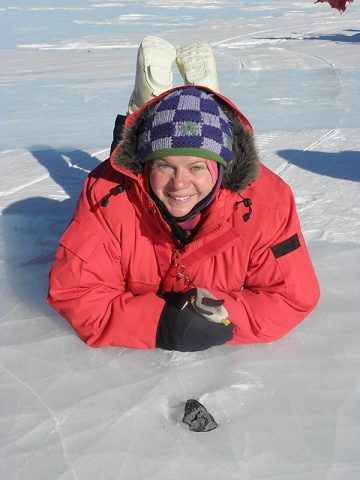 Barbara Cohen with a meteorite on the ice. (Juliane Gross)