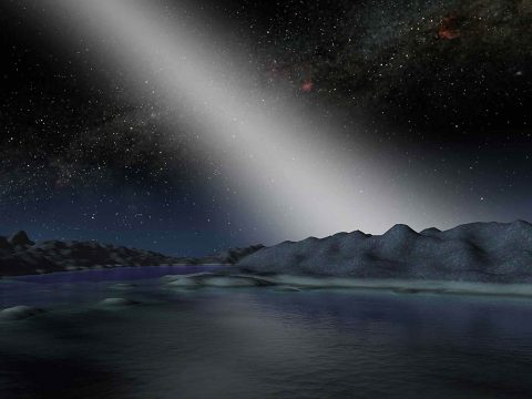 This artist's illustration shows what the sky might look like from a planet in a particularly dusty solar system. Dust that orbits a star in the plane of the solar system is called zodiacal dust, and the light reflected and scattered by that dust is called zodiacal light. (NASA/JPL-Caltech)