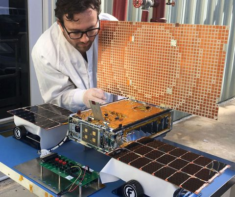 Engineer Joel Steinkraus uses sunlight to test the solar arrays on one of the Mars Cube One (MarCO) spacecraft at NASA's Jet Propulsion Laboratory. (NASA/JPL-Caltech)