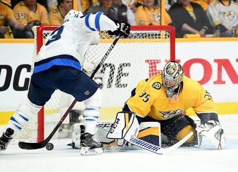 Winnipeg Jets left wing Brandon Tanev (13) scores against Nashville Predators goalie Pekka Rinne (35) during the first period in game one of the second round of the 2018 Stanley Cup Playoffs at Bridgestone Arena. (Christopher Hanewinckel-USA TODAY Sports)