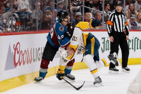 Colorado Avalanche defenseman Samuel Girard (49) and Nashville Predators right wing Miikka Salomaki (20) get tied up with each other in the first period in game six of the first round of the 2018 Stanley Cup Playoffs at the Pepsi Center. (Isaiah J. Downing-USA TODAY Sports)