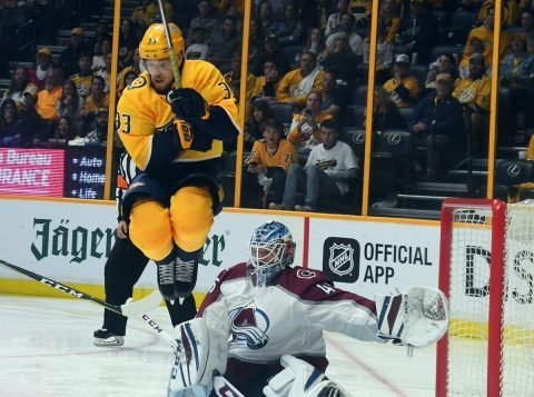 Apr 14, 2018; Nashville, TN, USA; Nashville Predators left wing Viktor Arvidsson (33) jumps to screen Colorado Avalanche goalie Jonathan Bernier (45) during the third period in game two of the first round of the 2018 Stanley Cup Playoffs at Bridgestone Arena. Mandatory Credit: Christopher Hanewinckel-USA TODAY Sports