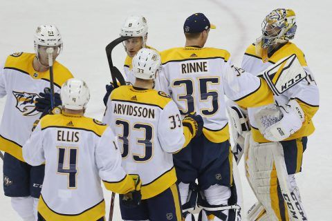 Apr 5, 2018; Washington, DC, USA; Nashville Predators goaltender Juuse Saros (74) celebrates with Predators goaltender Pekka Rinne (35) after their game against the Washington Capitals at Capital One Arena. The Predators won 4-3. Mandatory Credit: Geoff Burke-USA TODAY Sports