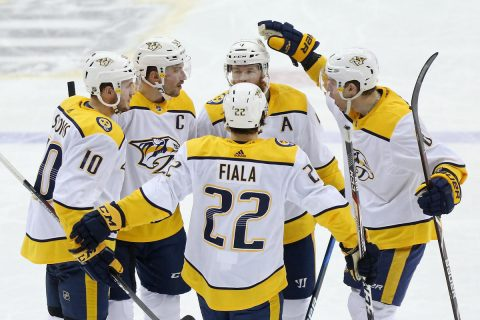 Apr 5, 2018; Washington, DC, USA; Nashville Predators defenseman Roman Josi (59) celebrates with teammates after scoring a goal against the Washington Capitals in the third period at Capital One Arena. The Predators won 4-3. Mandatory Credit: Geoff Burke-USA TODAY Sports