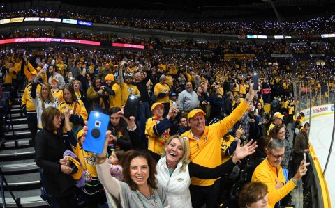 "Nashville Predators fans wave cell phones and sing the Beatles ""Let It Be\"" as referees review a goal late in the first period against the Columbus Blue Jackets at Bridgestone Arena. (Christopher Hanewinckel-USA TODAY Sports)"