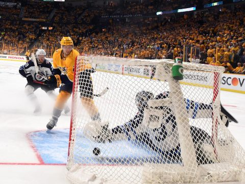 Nashville Predators left wing Kevin Fiala (22) scores the game winning goal against Winnipeg Jets goaltender Connor Hellebuyck (37) in second overtime in game two of the second round of the 2018 Stanley Cup Playoffs at Bridgestone Arena. (Christopher Hanewinckel-USA TODAY Sports)