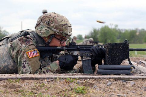 Sgt. Stephen Calderone, a native of Cleveland, Ohio, a Satellite Communications System Operator-Maintainer (25S) from 58 Signal Company, 101st Special Troops Battalion, 101st Airborne Division, shoots pop-up targets during the qualification portion of the 101st's NCO, Soldier of the Year at Range 9 on Fort Campbell, Ky., April 24. (Sgt. Sharifa Newton, 40th Public Affairs Detachment)